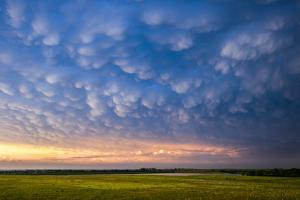 A Supercell Thunderstorm Produces Spectacular Mammatus Clouds at Sunset by Jim Reed