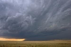 A Supercell Thunderstorm Rotates over a Vacant Field by Jim Reed