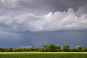 A Thunderstorm Moves over a Beautiful Landscape by Jim Reed