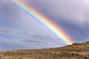 A Thunderstorm Produces a Vivid Rainbow by Jim Reed
