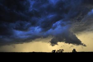 A Wall Cloud Develops Beneath a Picturesque Supercell Thunderstorm at Sunset by Jim Reed