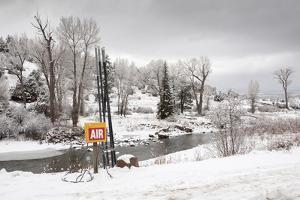 Beautiful Winter Landscape with a Colorful Air Compressor by Jim Reed