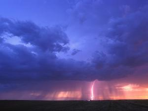 Lightning at Sunset by Jim Reed