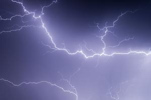 Lightning Wriggles across the Sky at Night by Jim Reed