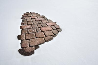 Part of a Brick Path in Snow