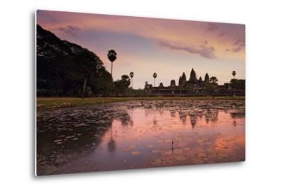 Sunrise Colors Reflect on a Lily Pad Filled Lake Fronting Angkor Wat