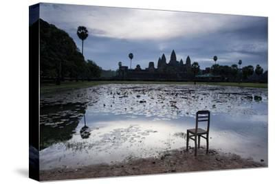 A Chair on the Shoreline of the Lake Fronting Angkor Wat
