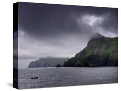 A Zodiac Explores the Scenic Hebrides Islands on a Cloudy Day