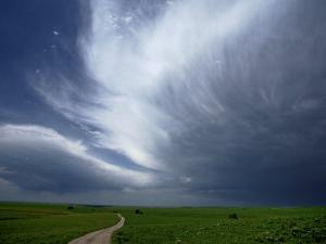 An afternoon thunderstorm coming through the Flint Hills by Jim Richardson