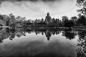 Bayon Temple and Lush Flora Cast a Mirror Reflection on Water by Jim Richardson