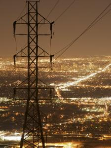 Denver Skyline Lights Up the Night, Framed by Power Lines by Jim Richardson
