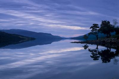 Loch Rannoch Casts a Mirror Reflection of Mountains, Sky, and Trees by Jim Richardson