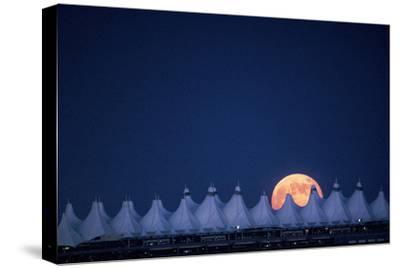 Moonrise over Denver International Airport