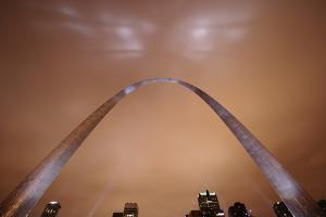 Theatrical lights give the surface of the Gateway Arch a night sheen. by Jim Richardson