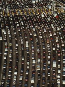 Cars Queue up at a Tollbooth on the Bay Bridge in Oakland, California, During Rush Hour by Jim Sugar