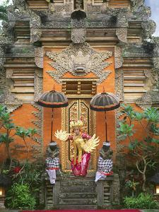 Balinese Dancer Wearing Traditional Garb Near Palace Doors in Ubud, Bali, Indonesia by Jim Zuckerman