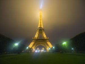 Eiffel Tower Illuminated in Fog and Rain at Night, Paris, France by Jim Zuckerman