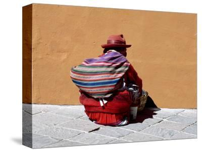 Old Woman with Sling Crouches on Sidewalk, Cusco, Peru