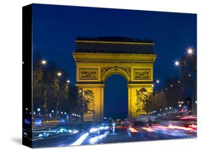 The Arc de Triomphe and the Champs Elysees at Twilight, Paris, France