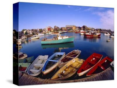 Town Buildings and Colorful Boats in Bay, Rockport, Maine, USA