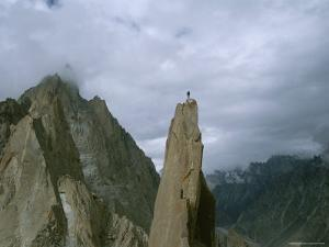 A Climber Stands Atop Tahir Tower, Karakoram Moutnains, Pakistan by Jimmy Chin