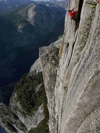 A Climber, Without a Rope, Clings with Fingertips to Half Dome by Jimmy Chin