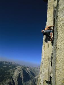 A Man Climbing Half Dome, Yosemite, California by Jimmy Chin
