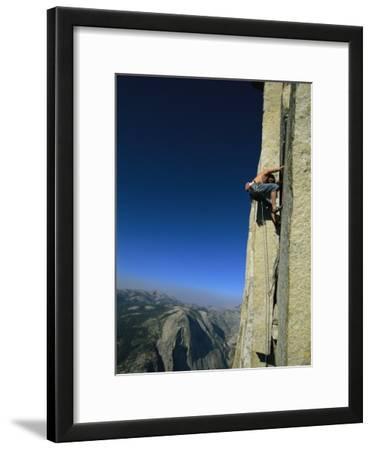 A Man Climbing Half Dome, Yosemite, California