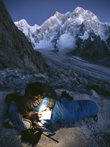 A Man in His Sleeping Bag in Charakusa, Karakoram, Pakistan by Jimmy Chin