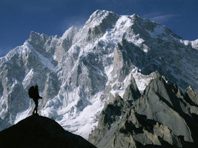 A Man Stands Silhouetted against the Karakoram Mountains, Pakistan by Jimmy Chin