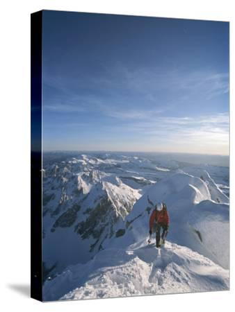 A Man Summits a Mountain in Grand Teton National Park, Wyoming