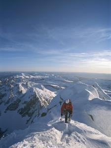 A Man Summits a Mountain in Grand Teton National Park, Wyoming by Jimmy Chin