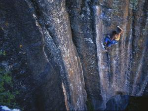 A Young Woman Climbs a Wall in Moab, Utah by Jimmy Chin