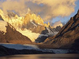 Clouds over Patagonias Snow-Covered Cerro Torre Massif by Jimmy Chin