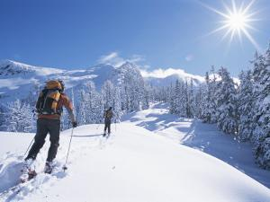 Cross-Country Skiers in the Selkirk Range, British Columbia, Canada by Jimmy Chin