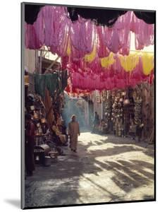 Figure in Wool Dyers Textile Souk, Marrakesh, Morocco, Africa by Jj Travel Photography