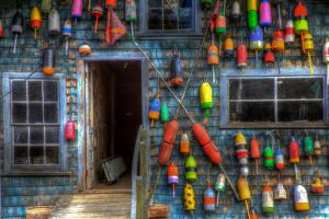 Buoys on an Old Shed at Bass Harbor, Bernard, Maine, USA by Joanne Wells