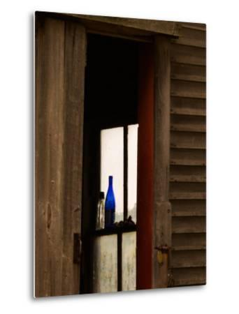 Old Blue Bottle in Window of Barn in Rural New England, Maine, USA