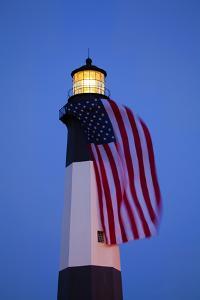 USA, Georgia, Tybee Island, Flag flying on lighthouse at Tybee Island. by Joanne Wells