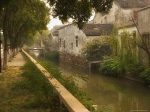 Canal and Houses, Souzhou (Suzhou), China by Jochen Schlenker