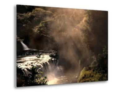 A Small Waterfall in the Jungle with Sun Rays