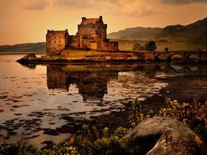 An Ancient Castle Beside a Loch in Scotland by Jody Miller