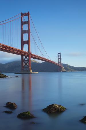 A Smooth-Water Reflection Of The Golden Gate Bridge In The Early Morning Light