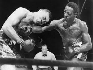 Joe Louis (Left), and Ezzard Charles, in a Heavyweight Title Bout, Sept. 27, 1950