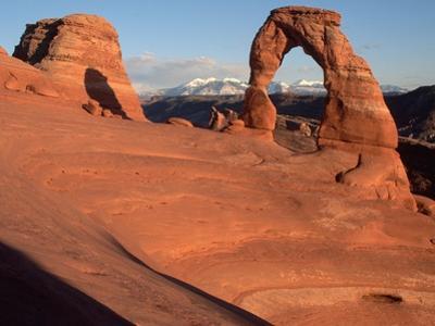 Delicate Arch in Low-Lying Sunlight by Joe McDonald