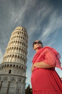 A Pregnant Woman in a Red Dress at the Foot of the Leaning Tower of Pisa by Joe Petersburger