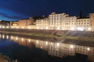Buildings Casting Reflections in the Arno River at Dawn by Joe Petersburger