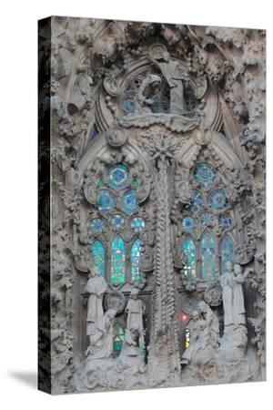 Ornate Sculpture and Stained Glass Windows at Gaudi's La Sagrada Familia Cathedral