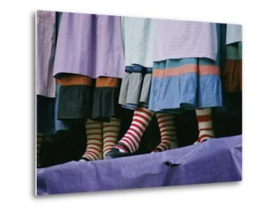 A View of People Wearing Striped Stockings