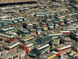 Buses Fill a Parking Lot by Joe Scherschel